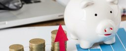 foto de cofre e moedas representando como calcular a rentabilidade de carteira de investimento